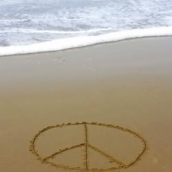peace sign on beach