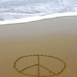 peace sign on beach